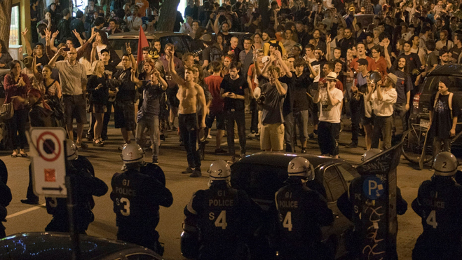May 24, 2012: Protesters and riot police face-off during a march against tuition fee hikes in Montreal.