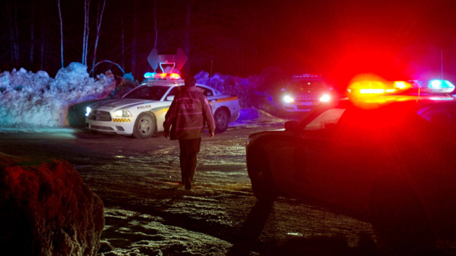 March 17, 2013: Police vehicles block a road just outside the town of Chertsey, Quebec, during a search for escaped prisoners.