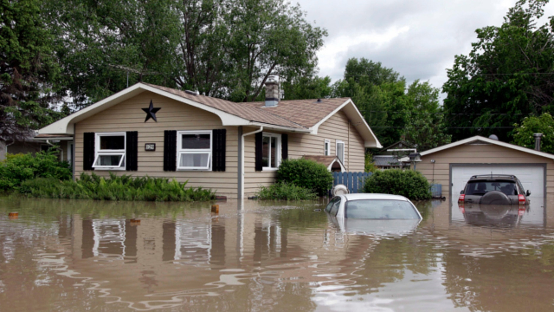 June 20, 2013: Cars and homes are submerged in flood waters in High River.