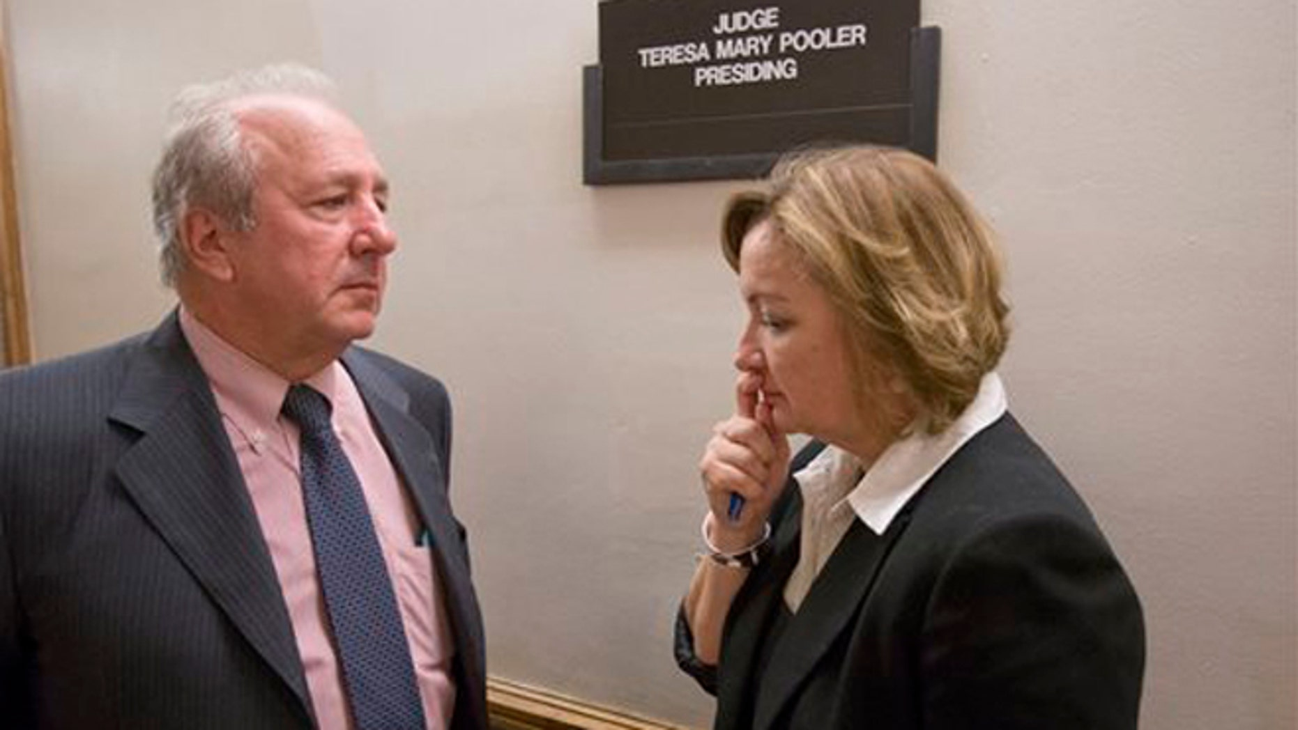 Canadian diplomat Roxanne Dube, right, speaks with attorney Curt Obront outside a courtroom at the Richard E. Gerstein Justice Building, Thursday, Feb. 4, 2016, in Miami. Dube's son, Marc Wabafiyebazu, 15, is charged with murder and other crimes in the March 30, 2015, drug-related South Florida shootout that killed his older brother and another youth. (AP Photo/Wilfredo Lee)