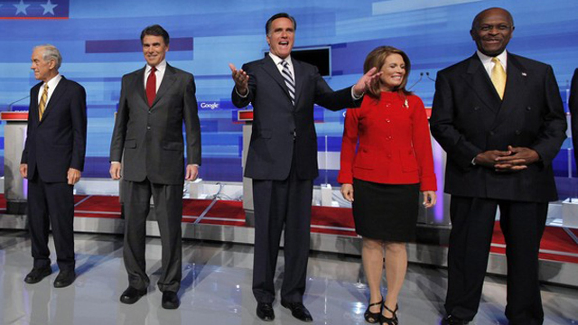 From left to right, Rep. Ron Paul; Texas Gov. Rick Perry; former Massachusetts Gov. Mitt Romney; Rep. Michele Bachmann; and businessman Herman Cain pose before a Fox News/Google debate in Orlando, Fla., Sept. 22.