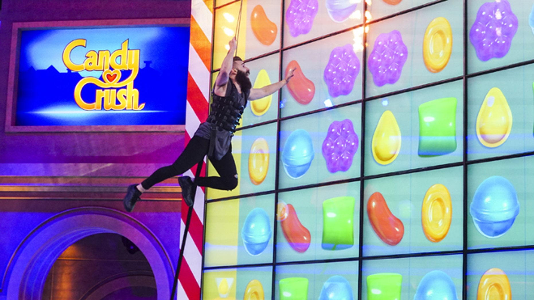 """A contestant competing on """"Candy Crush"""" which premieres on Sunday, July 9."""