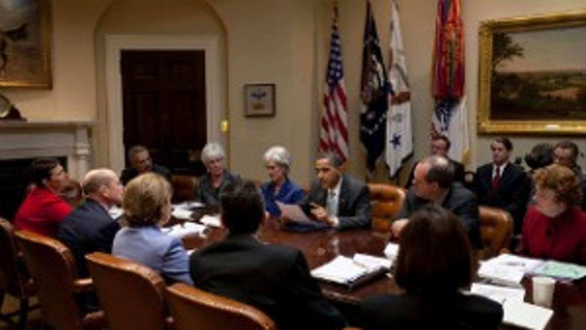 PresidentObama reads Natoma Canfield's letter to insurance executives, March 4th. White House Photo