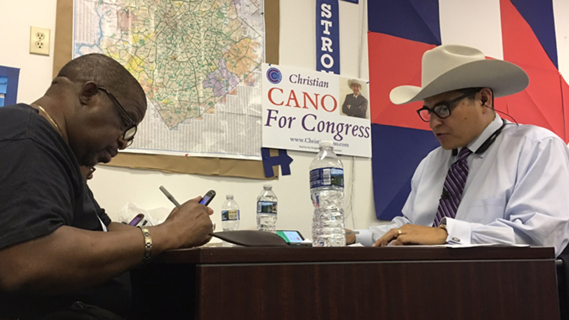 Shown here is North Carolina House candidate Christian Cano, right.