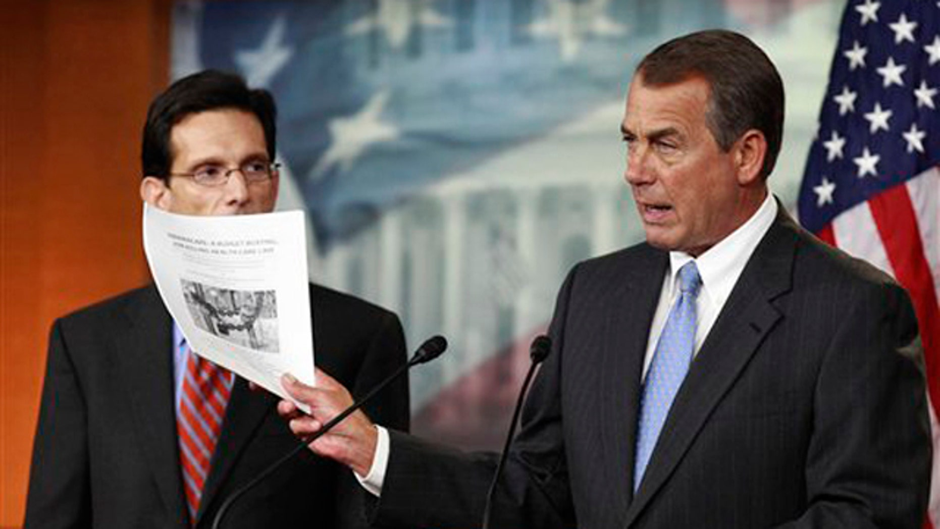 In this Jan. 6 file photo, House Speaker John Boehner, right, accompanied by House Majority Leader Eric Cantor, holds a copy of a proposal to repeal the health care law.