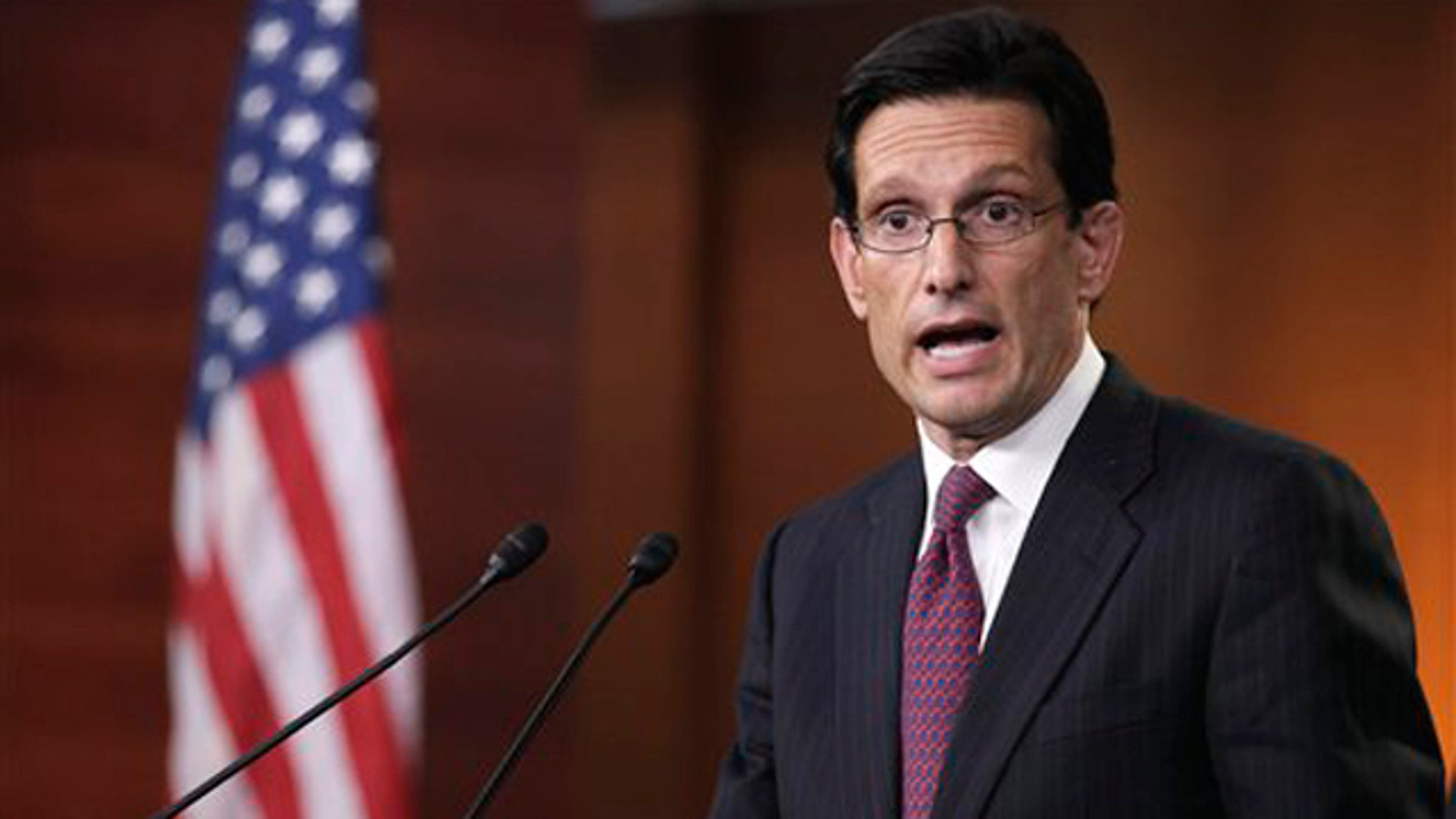 House Majority Leader Eric Cantor gestures during a news conference on Capitol Hill April 7.