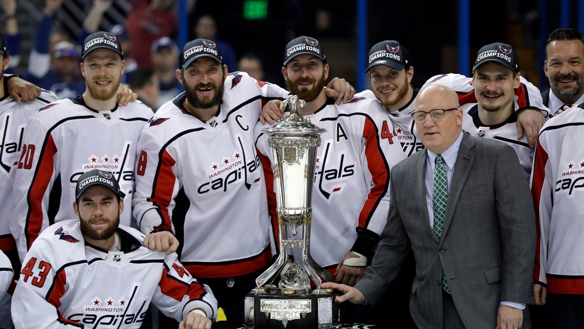 The Washington Capitals pose with the NHL's Eastern Conference championship trophy after eliminating Tampa Bay on Wednesday night.