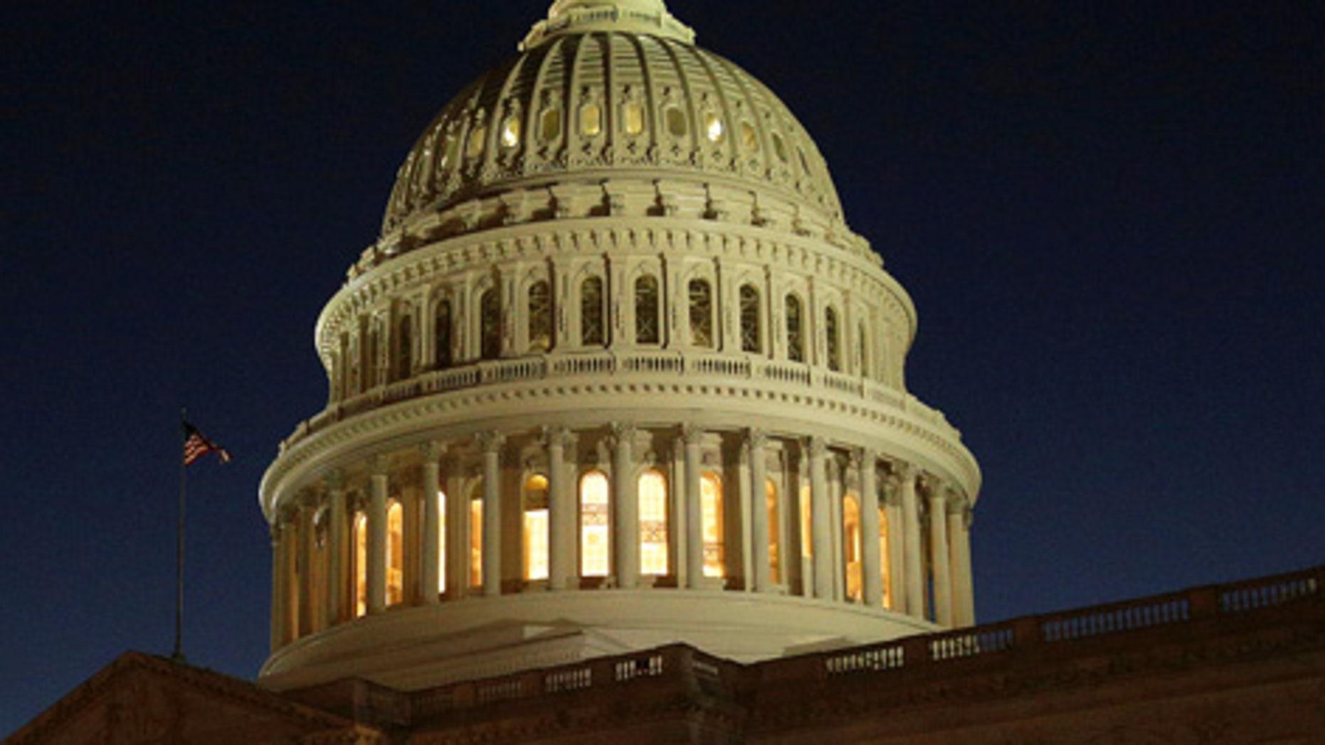 The U.S. Capitol Building is lit at sunset in Washington, U.S., December 20, 2016.  REUTERS/Joshua Roberts - RTX2VXU6