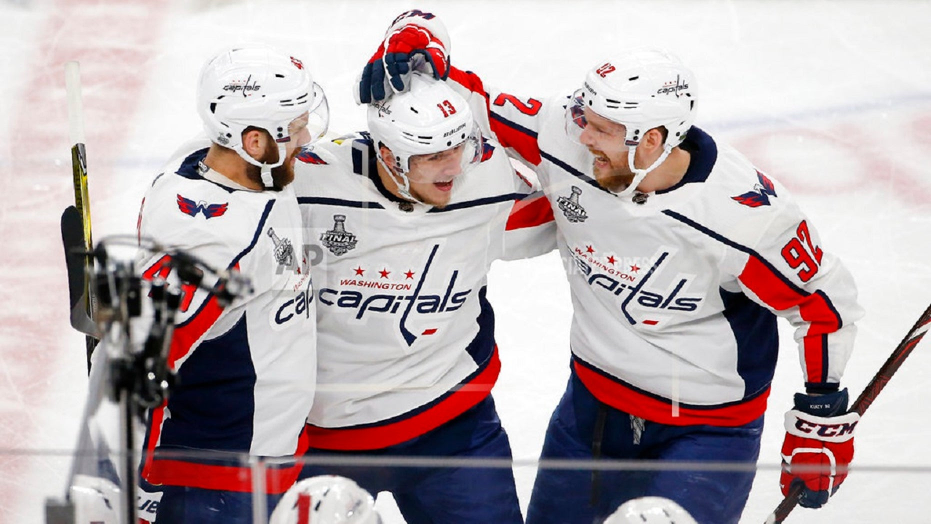 Washington Capitals left wing Jakub Vrana, center, celebrates his goal with right wing Tom Wilson, left, and center Evgeny Kuznetsov during the second period in Game 5 of the NHL hockey Stanley Cup Final against the Vegas Golden Knights, in Las Vegas, June 7, 2018.