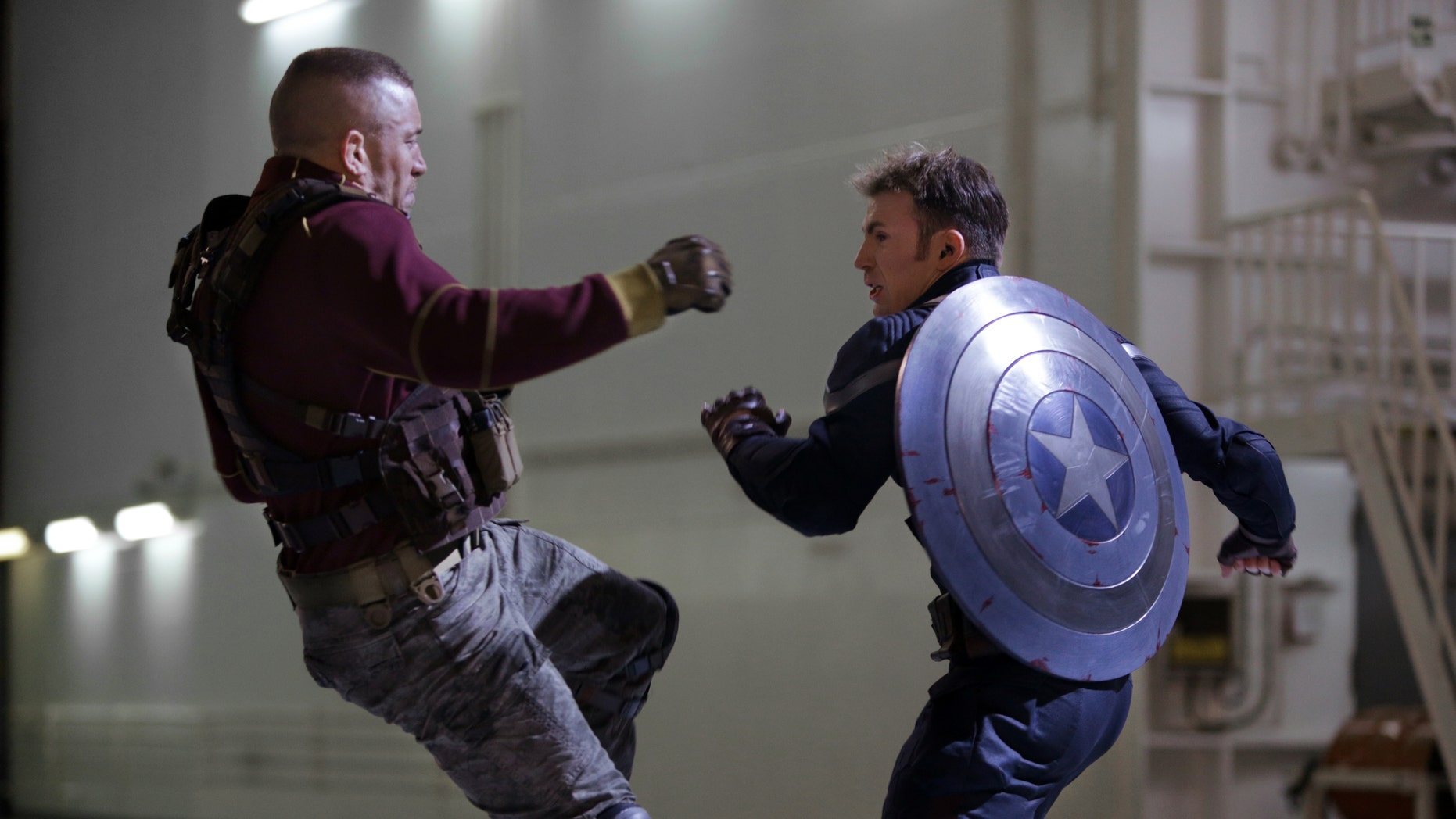 """George St-Pierre, left, and Chris Evans in a scene from """"Captain America: The Winter Soldier."""""""