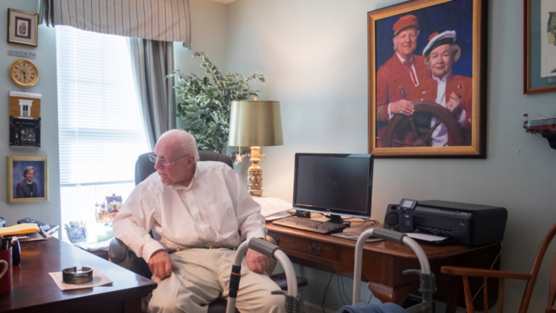 """This March 3, 2016, photo shows a portrait of W. Carter Merbreier, surrounded by a lifetime of memories in his home in Audubon, Pa. Merbreier helmed beloved Philadelphia children's TV show """"Captain Noah and his Magical Ark"""" for 27 years. He died Tuesday, Aug. 9, at age 90. (Ed Hille/The Philadelphia Inquirer via AP)"""