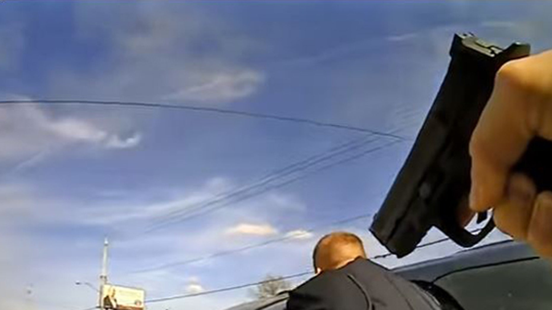 A screen grab depicts the conclusion of a tense incident between police officers and a man in Brooklyn.