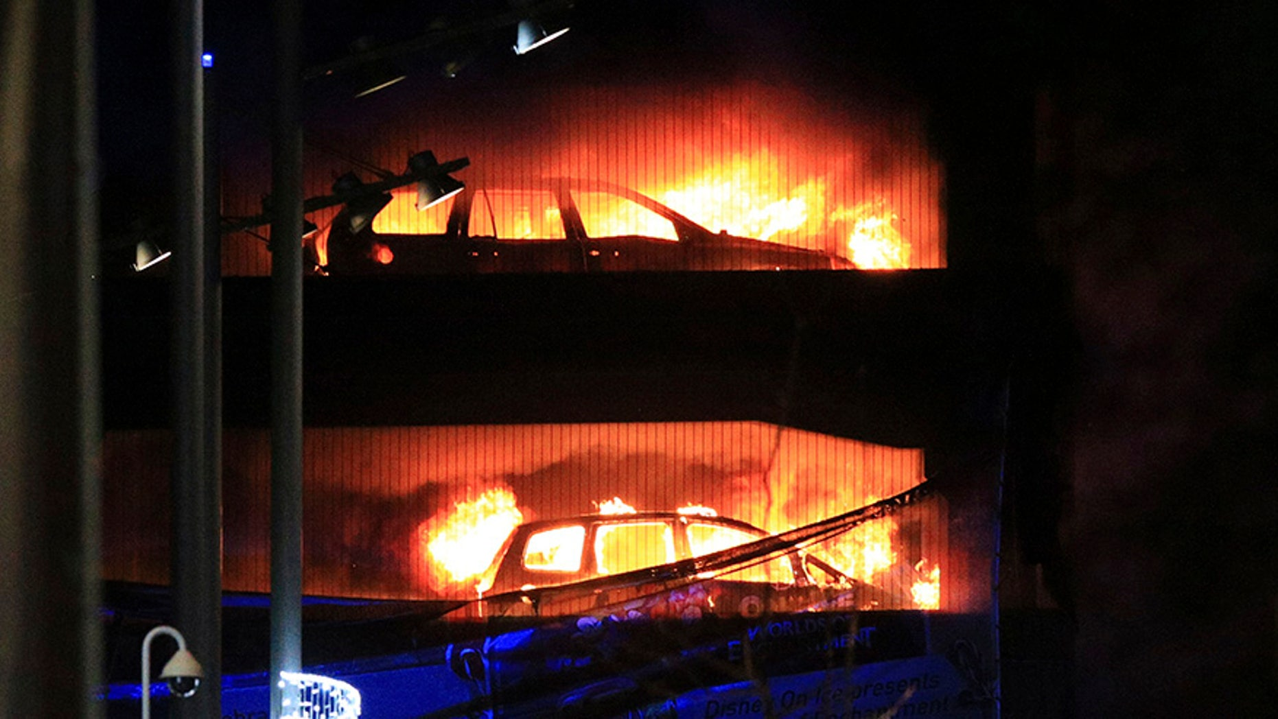 Vehicles burn during a blaze at a multi-storey car park at the Echo Arena on the waterfront in Liverpool, England Sunday, Dec. 31, 2017. An evening session of the Liverpool International Horse Show taking place in the Echo Arena was cancelled after horses were evacuated to safety. No one is known to have been injured in the fire. (Peter Byrne/PA via AP)