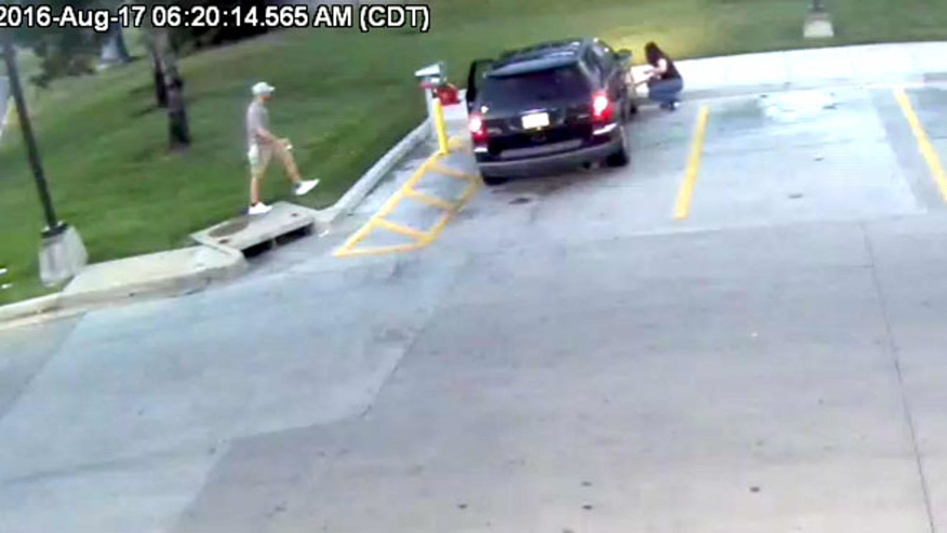Still from a video showing a carjacking at an Independence, Missouri, gas station Wednesday. (Independence Police Department)