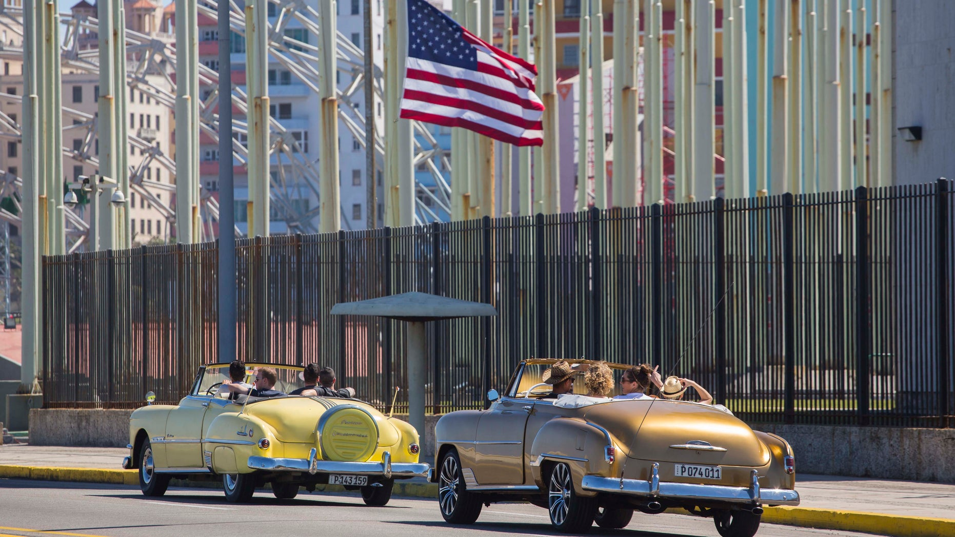 American convertibles pass by the United States embassy in Havana, Cuba, on Feb. 18, 2016.
