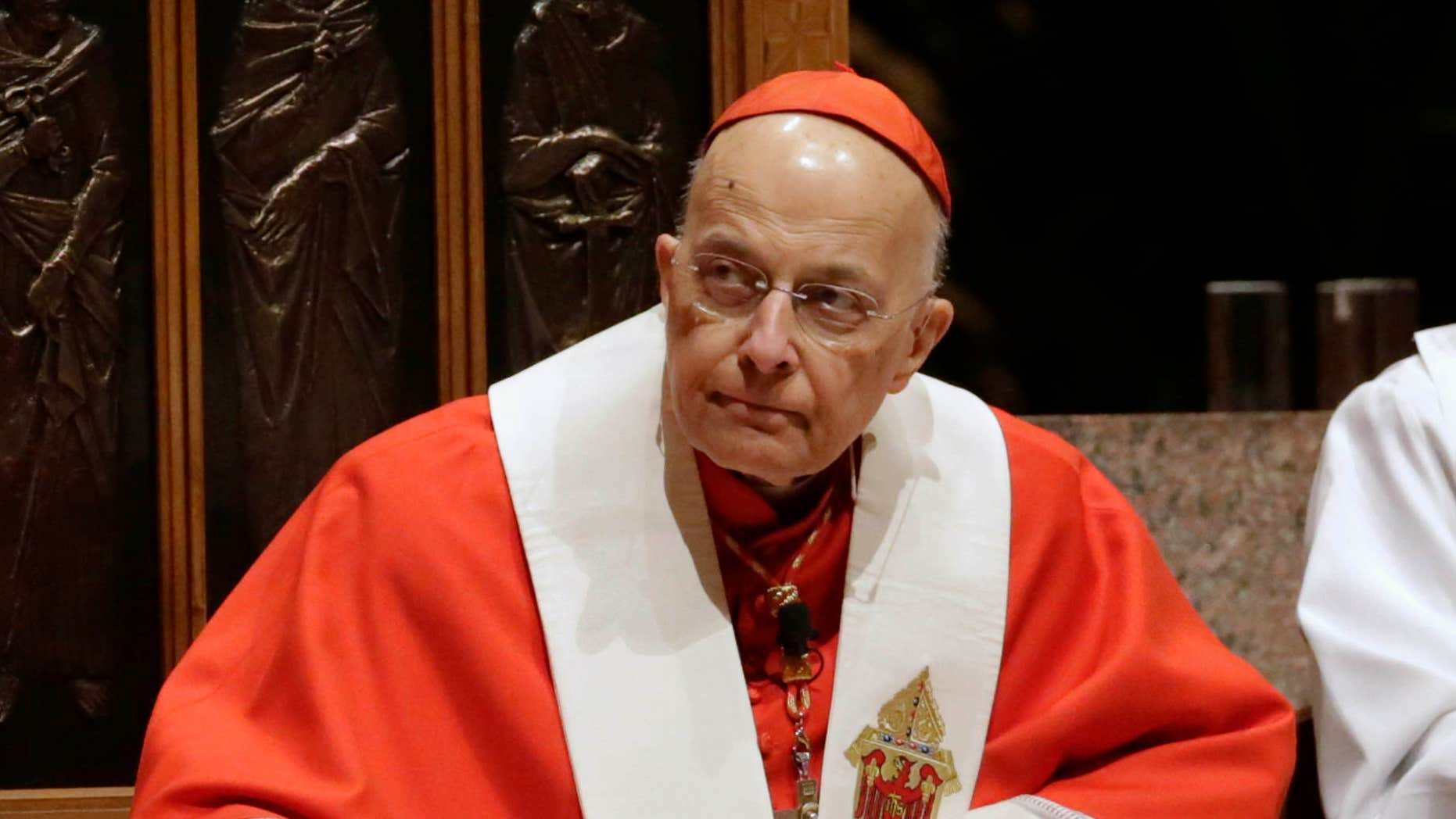 Nov. 17, 2014: Retiring Cardinal Francis George listens at Holy Name Cathedral in Chicago during Bishop Blase Cupich's Rite of Reception service.
