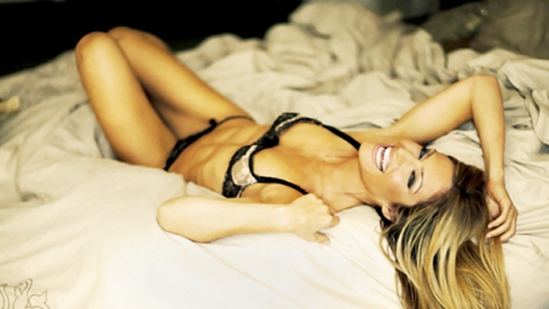 Rebecca Cardon sure looks happy to be in bed alone.