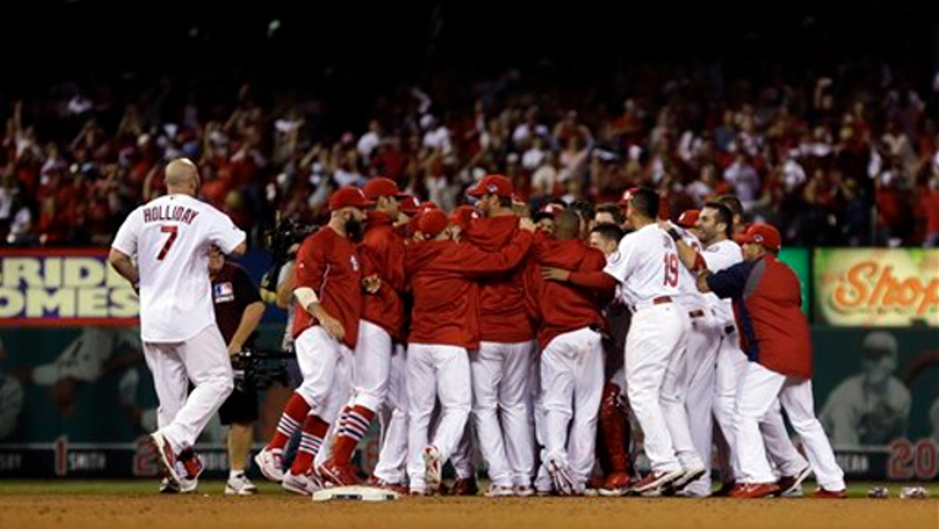 Oct. 12, 2013: St. Louis Cardinals' Carlos Beltran is mobbed by teammates after his game-winning hit during the 13th inning of Game 1 of the National League baseball championship series against the Los Angeles Dodgers in St. Louis.
