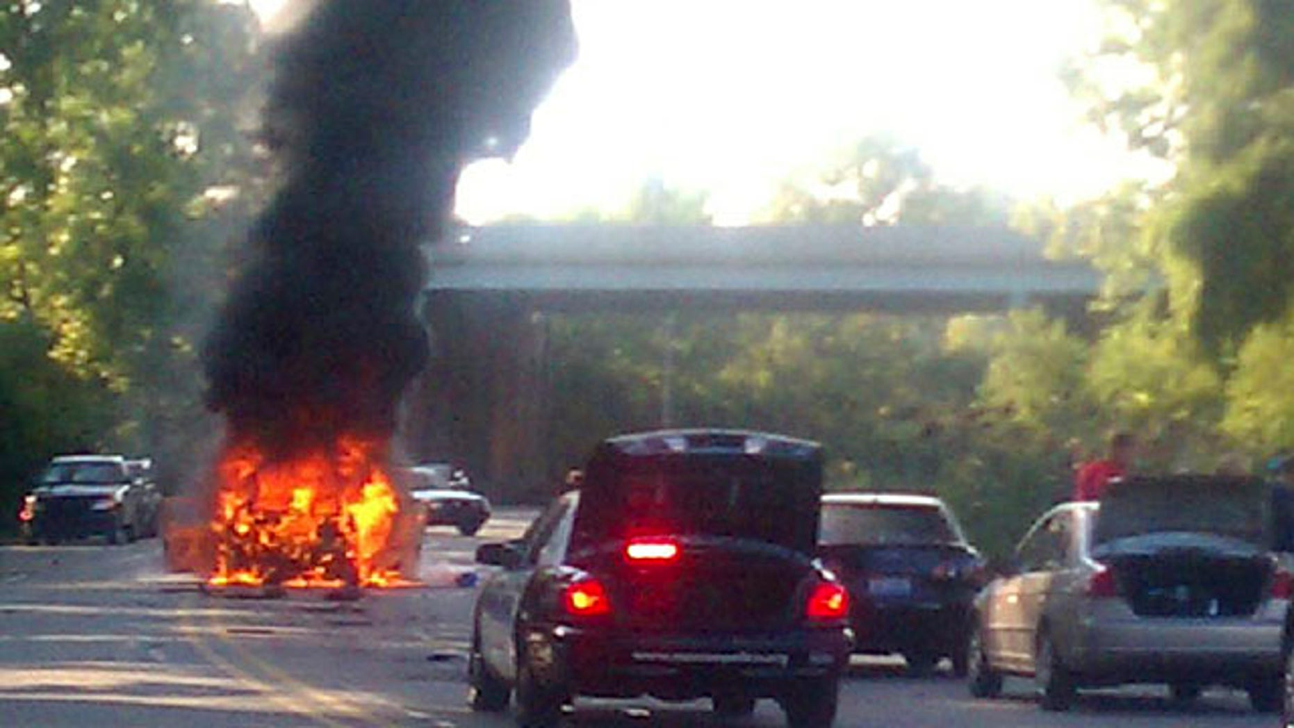 Sept. 20: A car burns after it exploded while being driven by a man and his two sons  in Monroe, Mich.