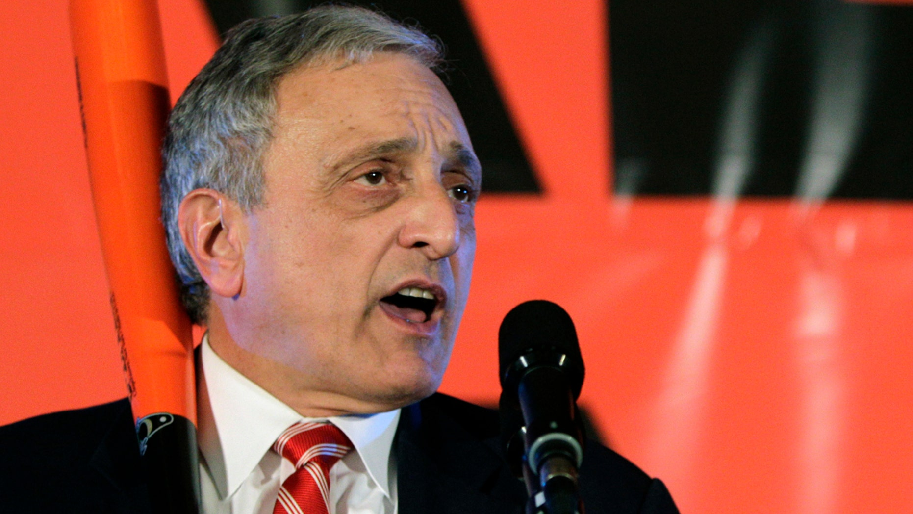 In this Nov. 2, 2010, file photo, Republican gubernatorial candidate Carl Paladino holds a baseball bat as he concedes the election in Buffalo, N.Y.