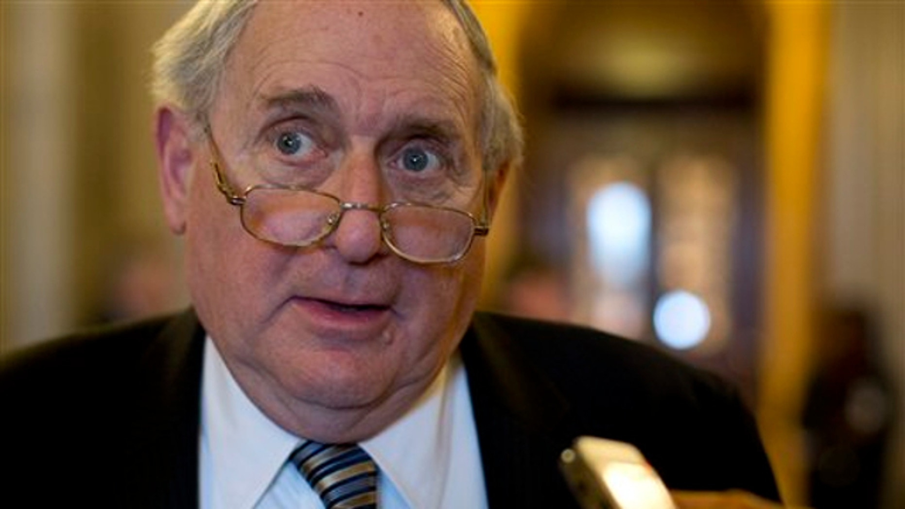 Feb. 26, 2013: Senate Armed Services Committee Chairman Sen. Carl Levin, D-Mich. speaks with reporters on Capitol Hill in Washington.
