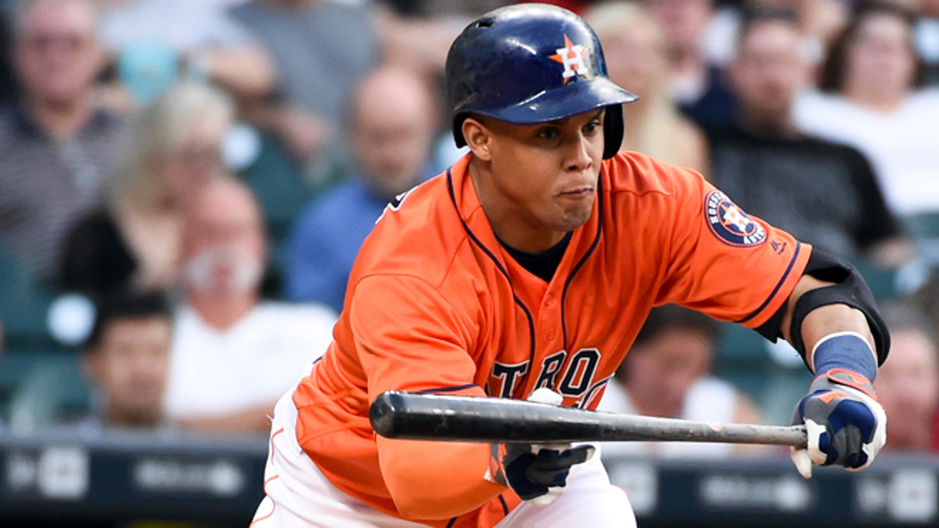 Houston Astros' Carlos Gomez bunts in the second inning of a baseball game against the Seattle Mariners, Friday, May 6, 2016, in Houston. (AP Photo/Eric Christian Smith)