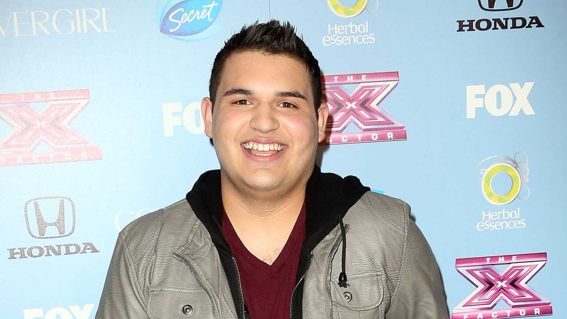 """LOS ANGELES, CA - NOVEMBER 04:  Singer Carlos Guevara attends Fox's """"The X Factor"""" Finalist Party at the SLS Hotel on November 4, 2013 in Los Angeles, California.  (Photo by Frederick M. Brown/Getty Images)"""