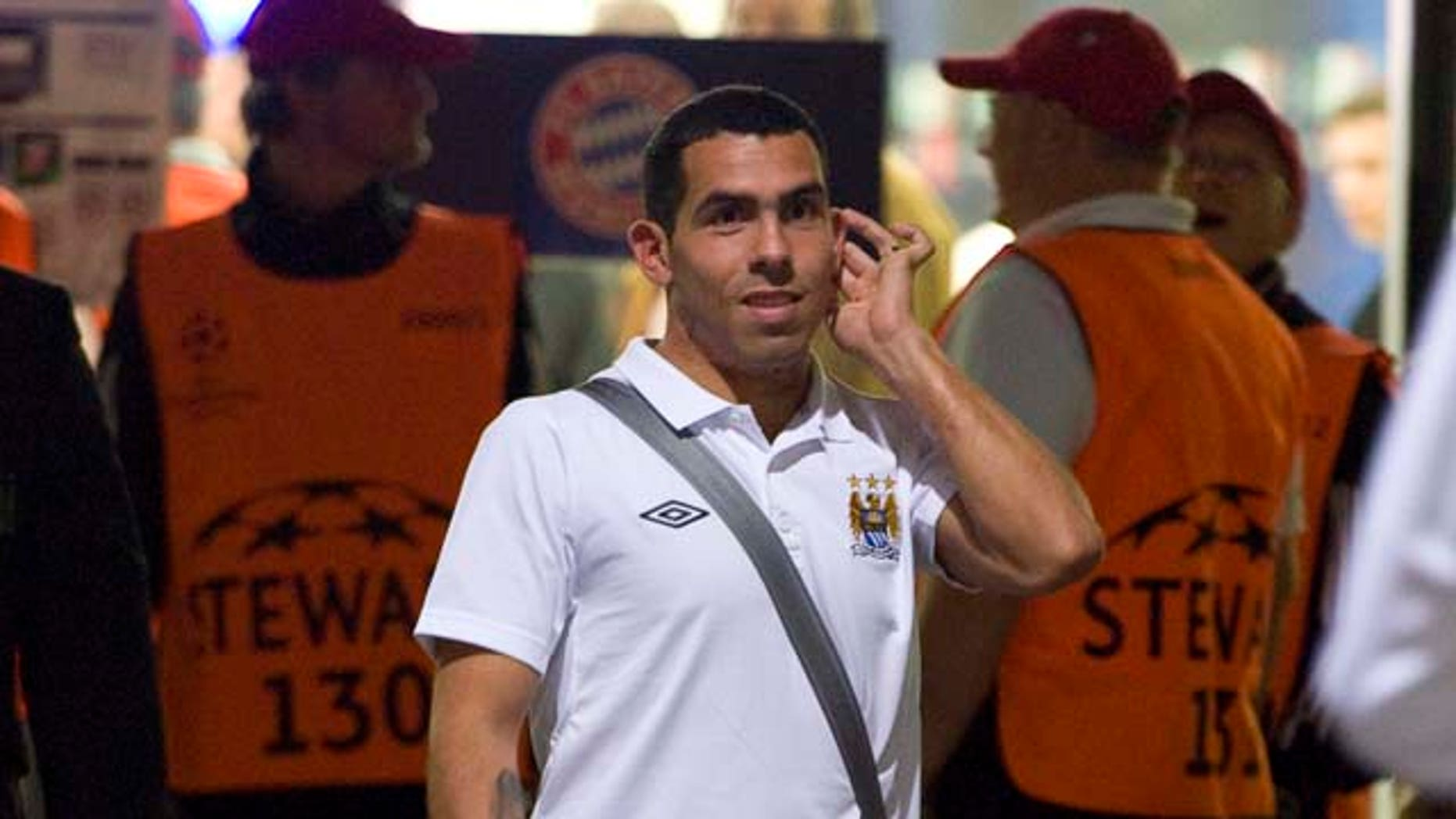 Manchester City's Carlos Tevez leaves the stadium after the Group A Champions League soccer match between FC  Bayern Munich and Manchester City FC in Munich, southern Germany, on Tuesday , Sept. 27, 2011. Munich won 2-0. (AP Photo / Kerstin Joensson)