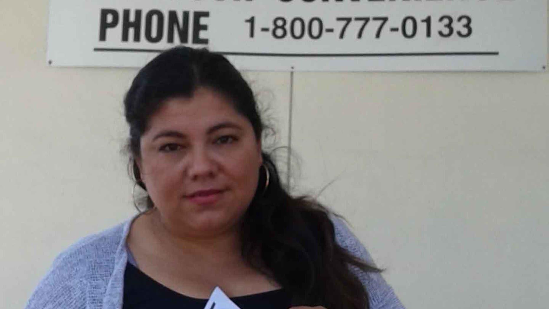 Carmela Gonzalez shows her new driver's license.