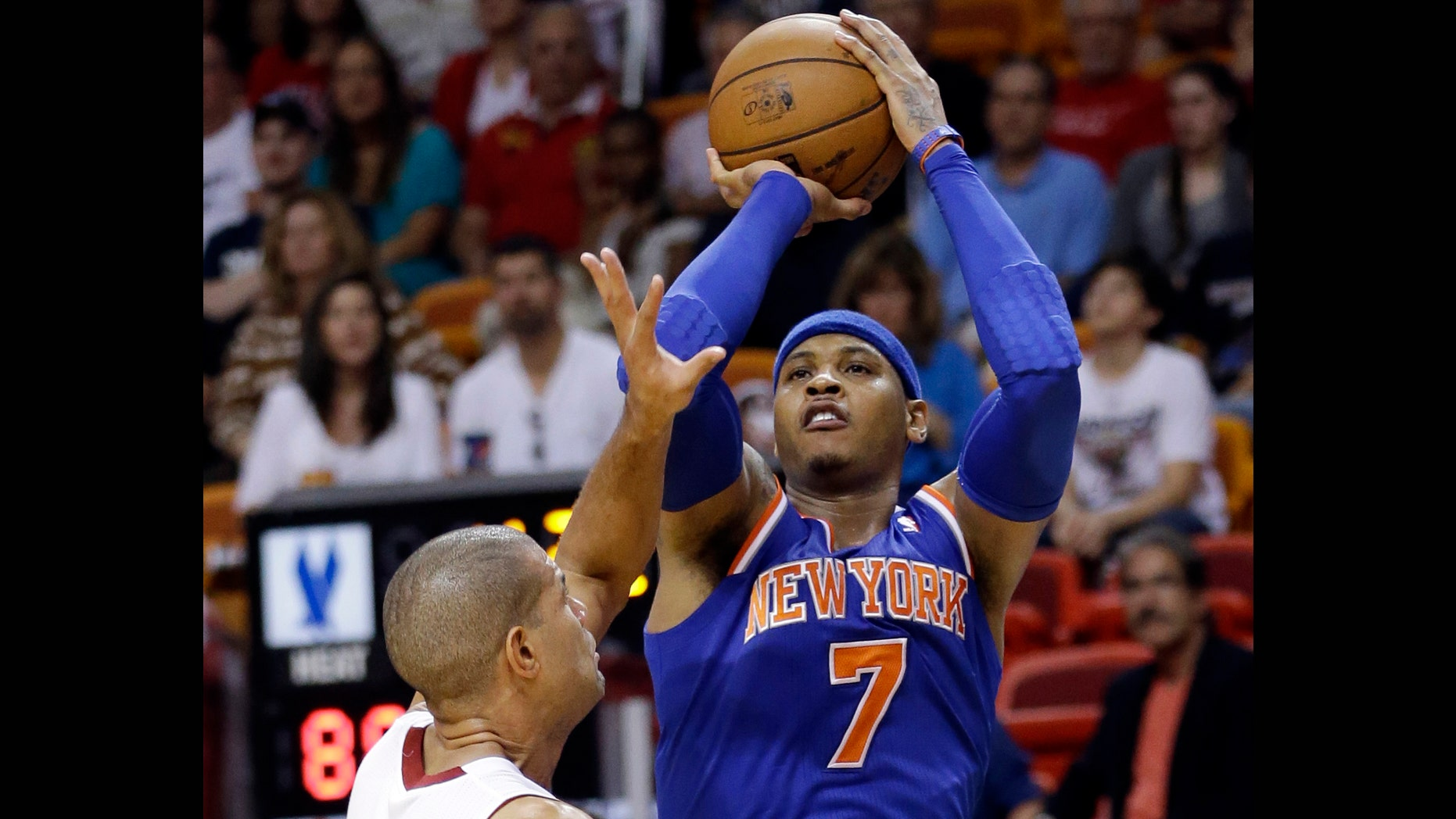 New York Knicks forward Carmelo Anthony (7) takes a shot against Miami Heat forward Shane Battier during the second half of an NBA basketball game, Tuesday, April 2, 2013 in Miami. Anthony tied his career high with 50 points in the Knicks' 102-90 win. (AP Photo/Wilfredo Lee)