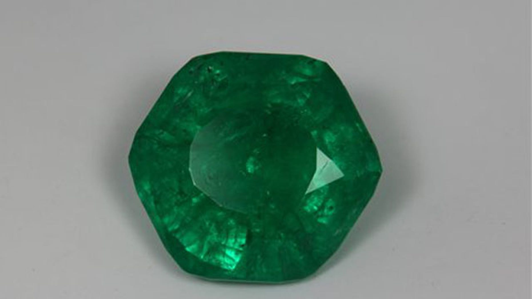 This undated shows the Carolina Emperor emerald after its final cut. Gem experts say the 65-carat emerald yielded at a North Carolina farm may be the biggest ever uncovered in North America (AP).