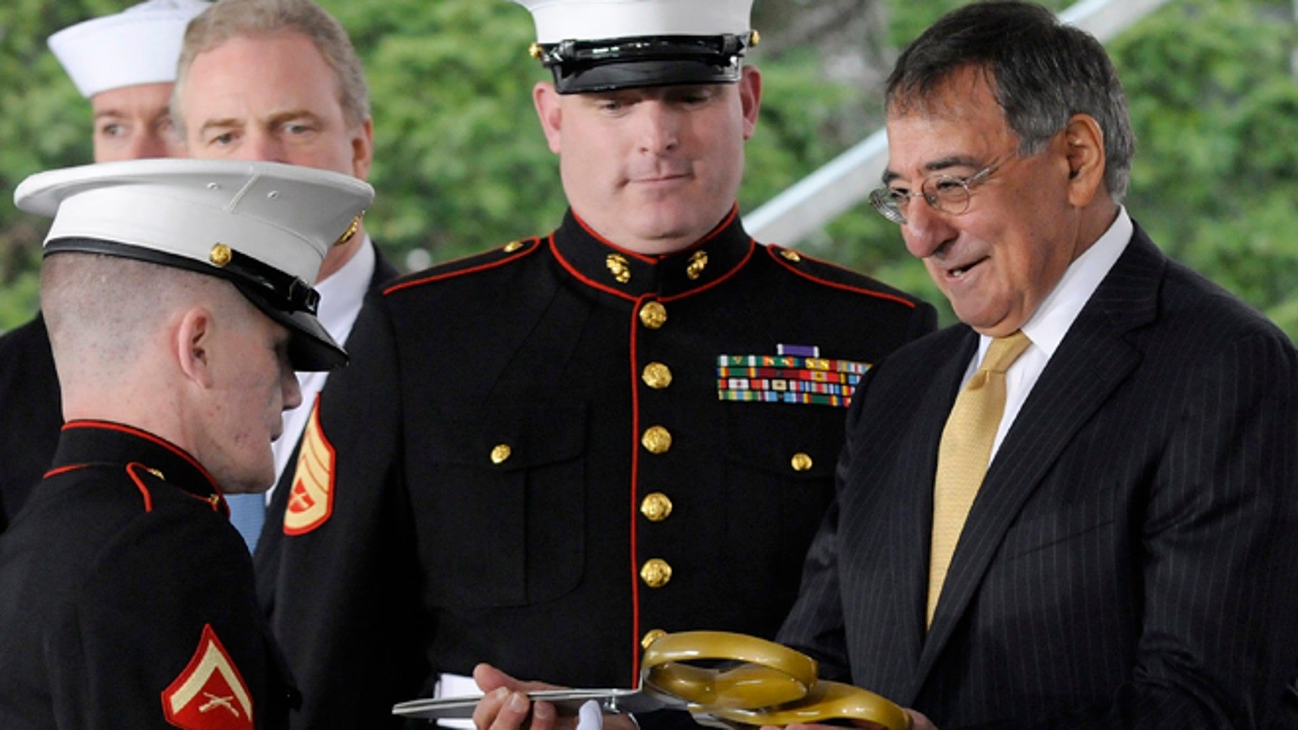 FILE: U.S. Defense Secretary Leon Panetta, right, handles the ceremonial scissors from U.S Marine Corps Lance Corporal Kyle Carpenter to cut the ribbon at the dedication ceremony at the Walter Reed National Military Medical Center in Bethesda.