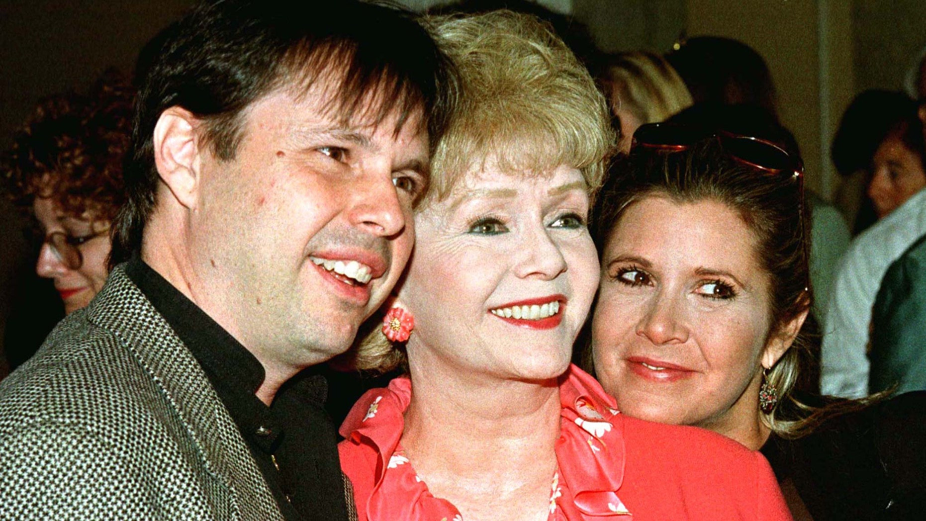 Actress Debbie Reynolds (C) and son, filmmaker Todd Fisher, and daughter, screenwriter Carrie Fisher, arrive September 17 at a luncheon hosted by the American Film Institute. Reynolds and her children will be honored by the AFI with the Platinum Circle Award which pays tribute to an entire family whose creative contributions have enhanced the entertainment community.