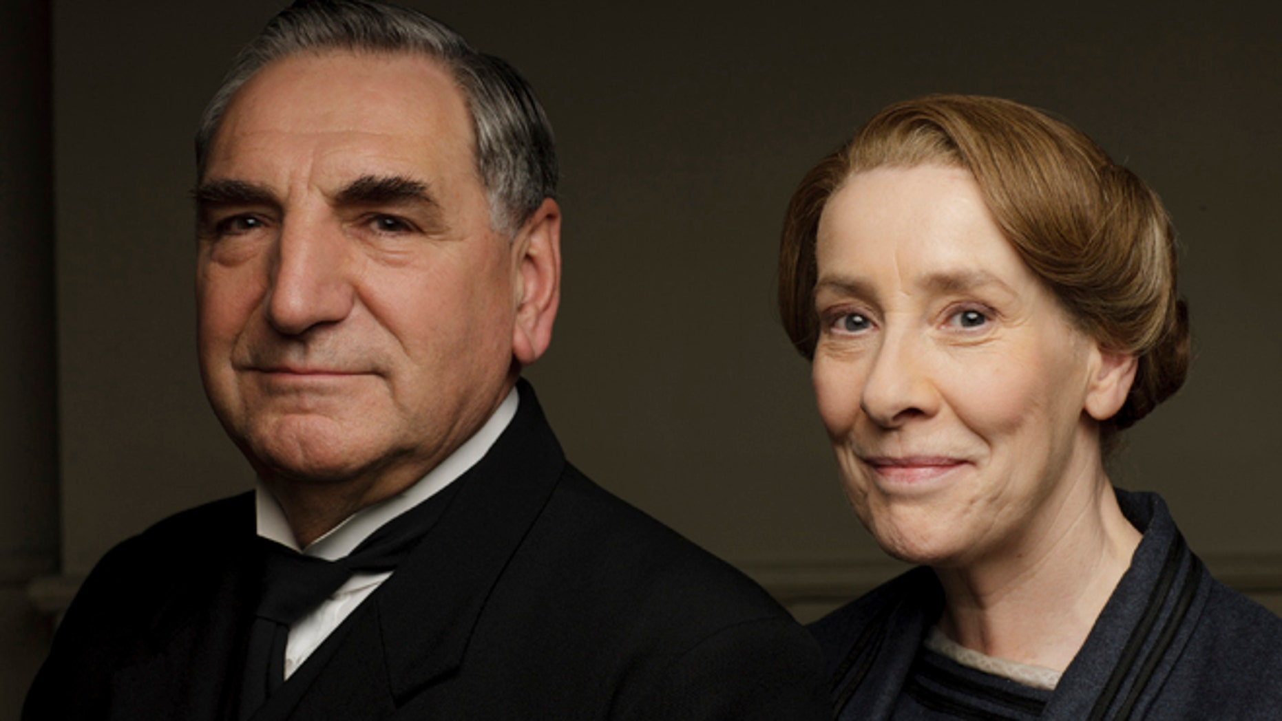 "Jim Carter, left, as Mr Carson and Phyllis Logan as Mrs Hughes from series six of ""Downton Abbey."""