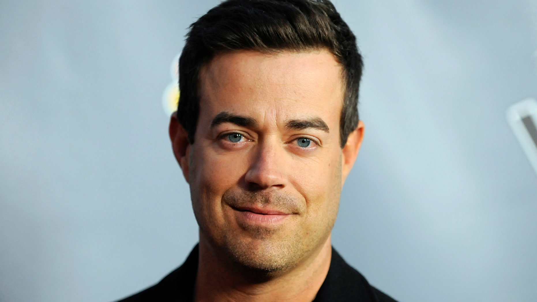 """Television personality and """"The Voice"""" host Carson Daly arrives at the """"The Voice"""" Season 4 premiere screening in Los Angeles, California March 20, 2013."""