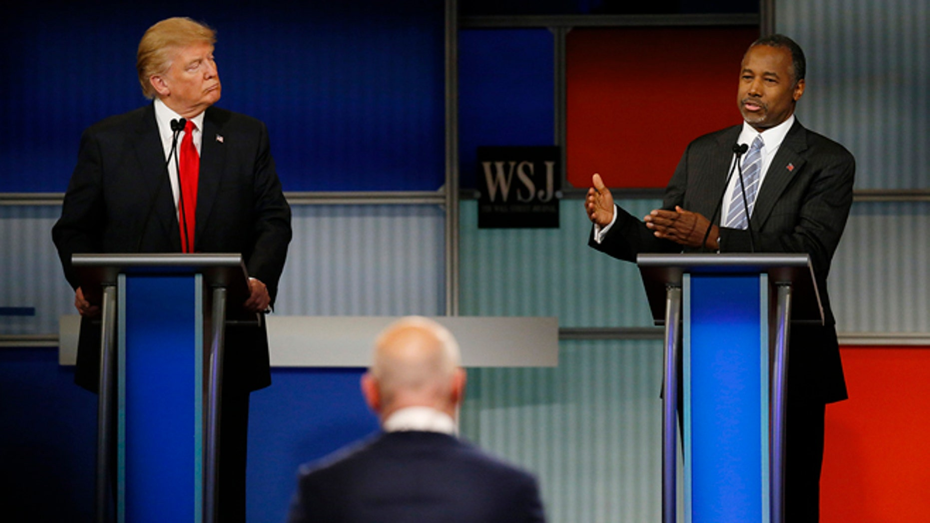 November 10, 2015: Republican U.S. presidential candidate businessman Donald Trump (L) listens as rival candidate Dr. Ben Carson speaks during the debate held by Fox Business Network for the top 2016 U.S. Republican presidential candidates in Milwaukee, Wisconsin. (REUTERS/Jim Young)