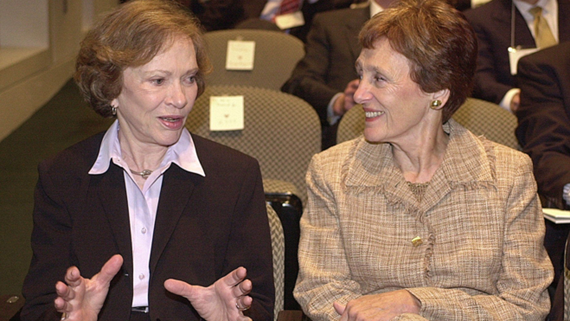 Sept. 17, 2003: Former first lady Rosalynn Carter, left, and wife of former Vice President Walter Mondale, Joan Mondale, chat prior to the opening of a symposium for the 25th anniversary of the Camp David peace accords between Israel and Egypt.