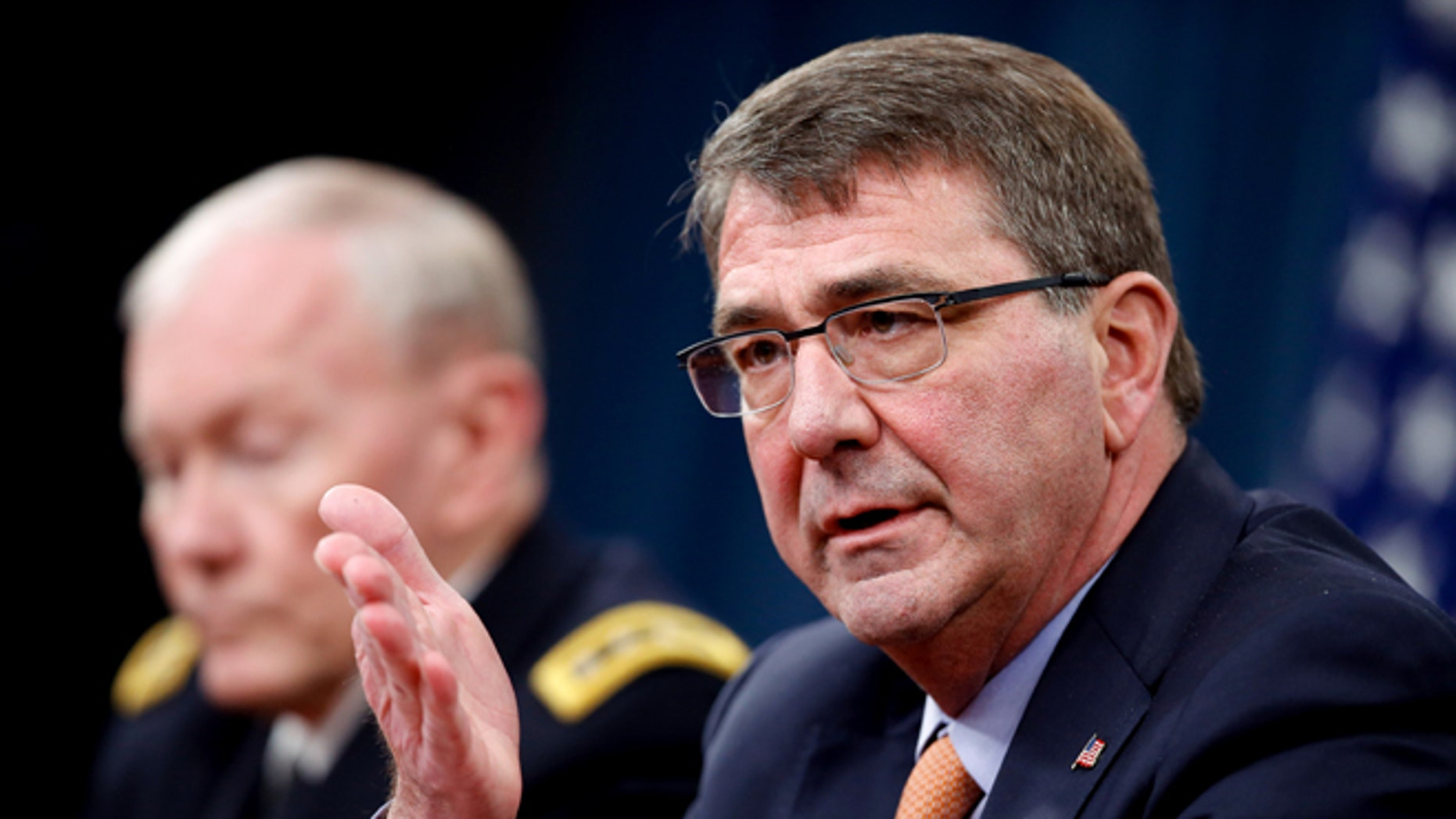 April 16, 2015: Defense Secretary Ash Carter, right, accompanied by Joint Chiefs Chairman Gen. Martin Dempsey, speaks during a news conference at the Pentagon.