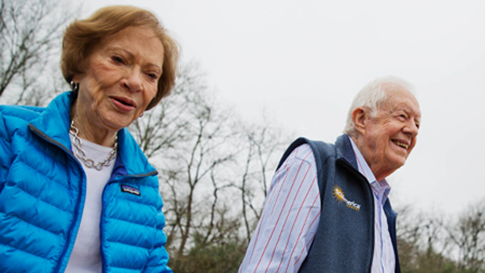 Former President Jimmy Carter and his wife Rosalynn arrive for a ribbon cutting ceremony for a solar panel project on their Georgia farm