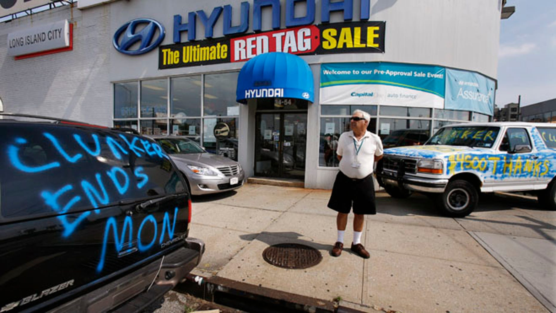 "Aug. 24, 2009: A man looks at a car advertising the last day of the ""Cash For Clunkers"" auto rebates program outside a Hyundai dealership."