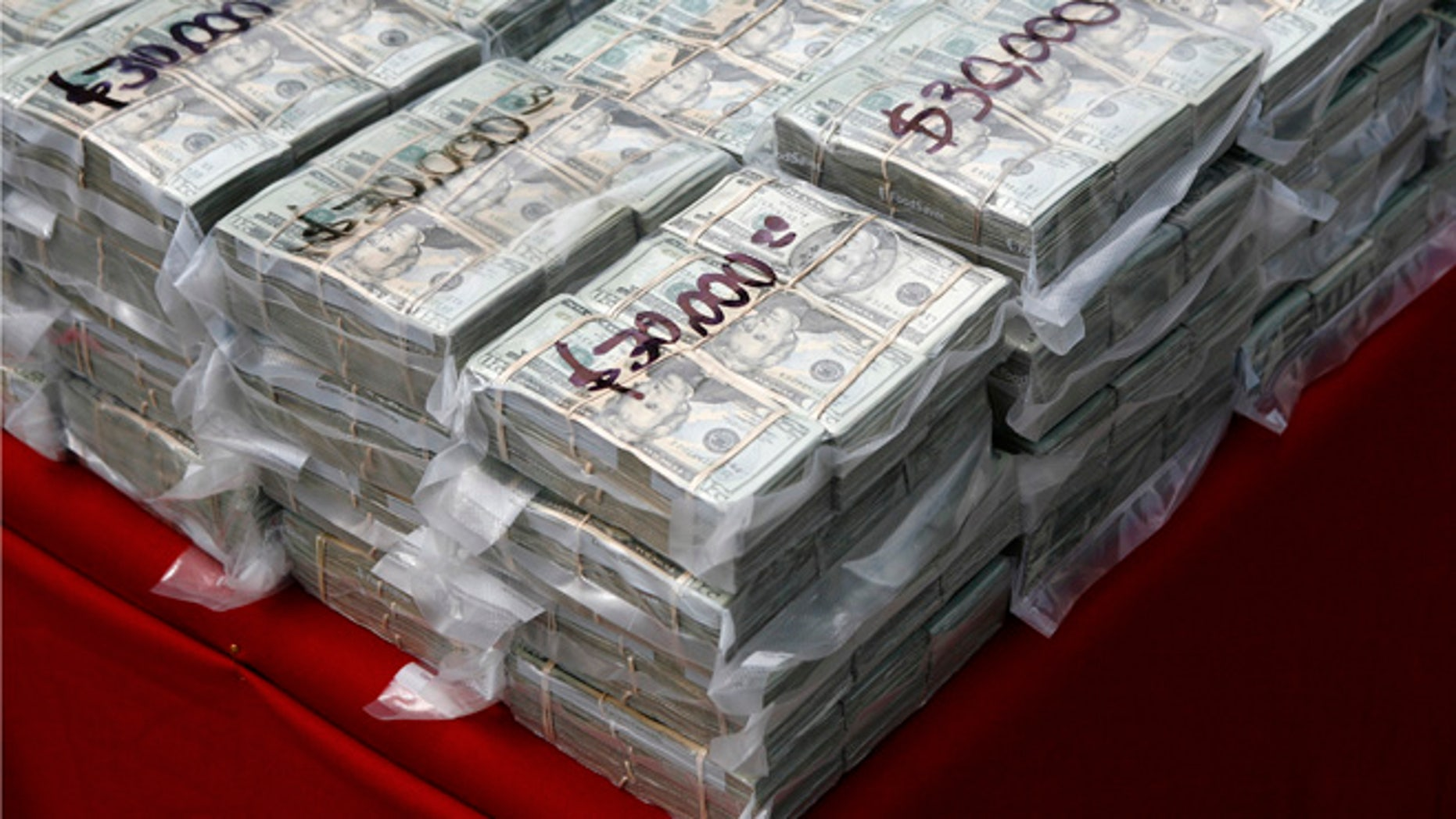 FILE: Packages of money seized during a drug sting.