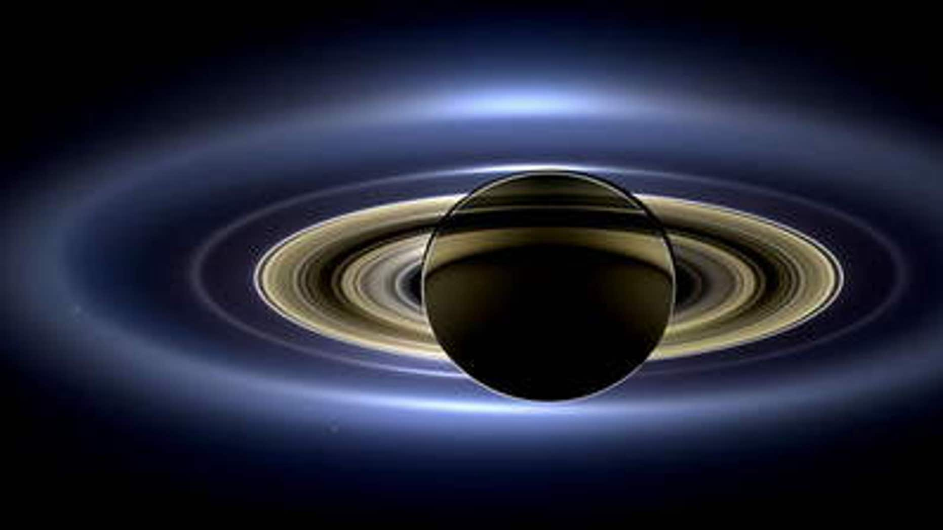 A new mosaic of Saturn and rings made by Cassini spacecraft, brightened version with contrast and color enhanced. Image released Nov. 12, 2013.