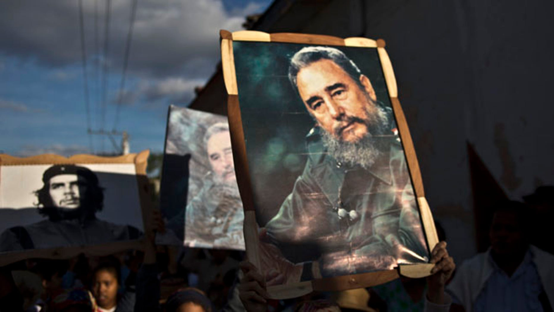 Jan. 8, 2015: Children carry framed images of Fidel Castro and Che Guevara in a caravan tribute marking the 56th anniversary of the original street party that greeted a triumphant Castro and his rebel army.