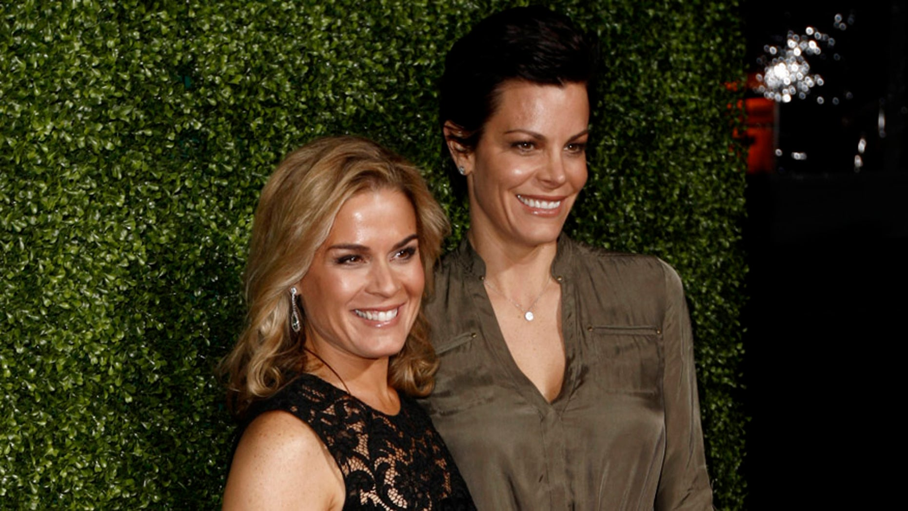FILE - In this Jan. 6, 2011 file photo, Cat Cora, left, and Jennifer Cora arrive at the Oprah Winfrey Network Television Critics Association 2011 Winter Press Tour Cocktail Reception in Pasadena, Calif. Cat Cora announced Monday, Nov. 9, 2015, that she and her partner of 17 years, Jennifer Cora, are divorcing and plan to jointly raise their four sons. Court records in Santa Barbara, California, show the pair filed for divorce in late October 2015. (AP Photo/Matt Sayles, File)