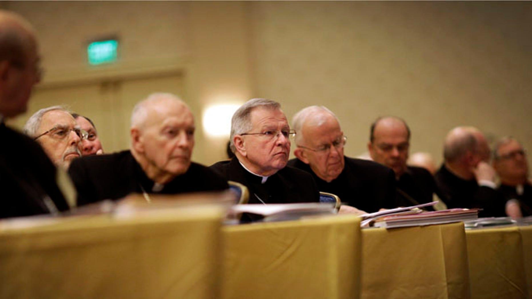 Nov. 11, 2013: Archbishop Gregory Aymond of New Orleans, center, listens to a report as he sits with fellow bishops at the United States Conference of Catholic Bishops' annual fall meeting in Baltimore.