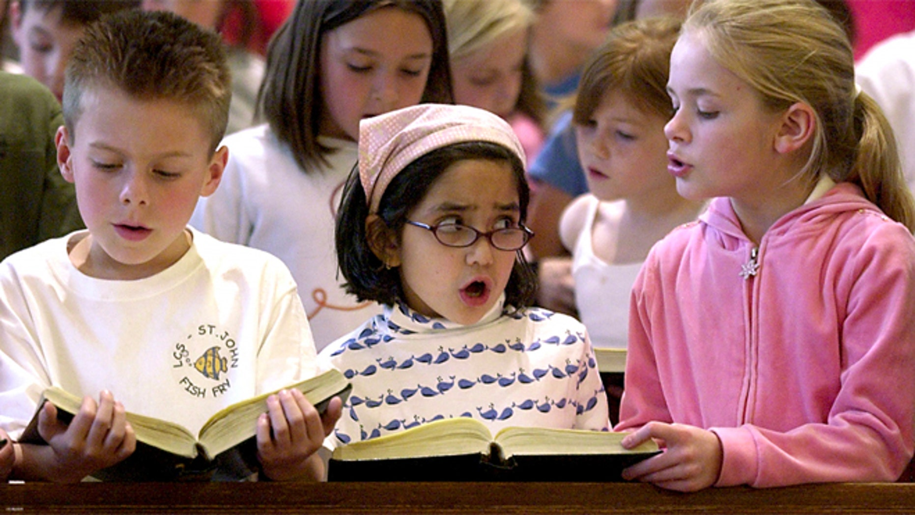 FILE: Catholic school students in Kansas sing at a prayer service.