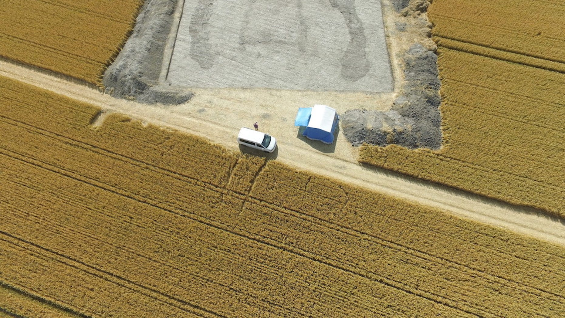 Archaeologists looking at aerial photography found a hidden long barrow, or Neolithic burial chamber, hidden beneath a wheat field