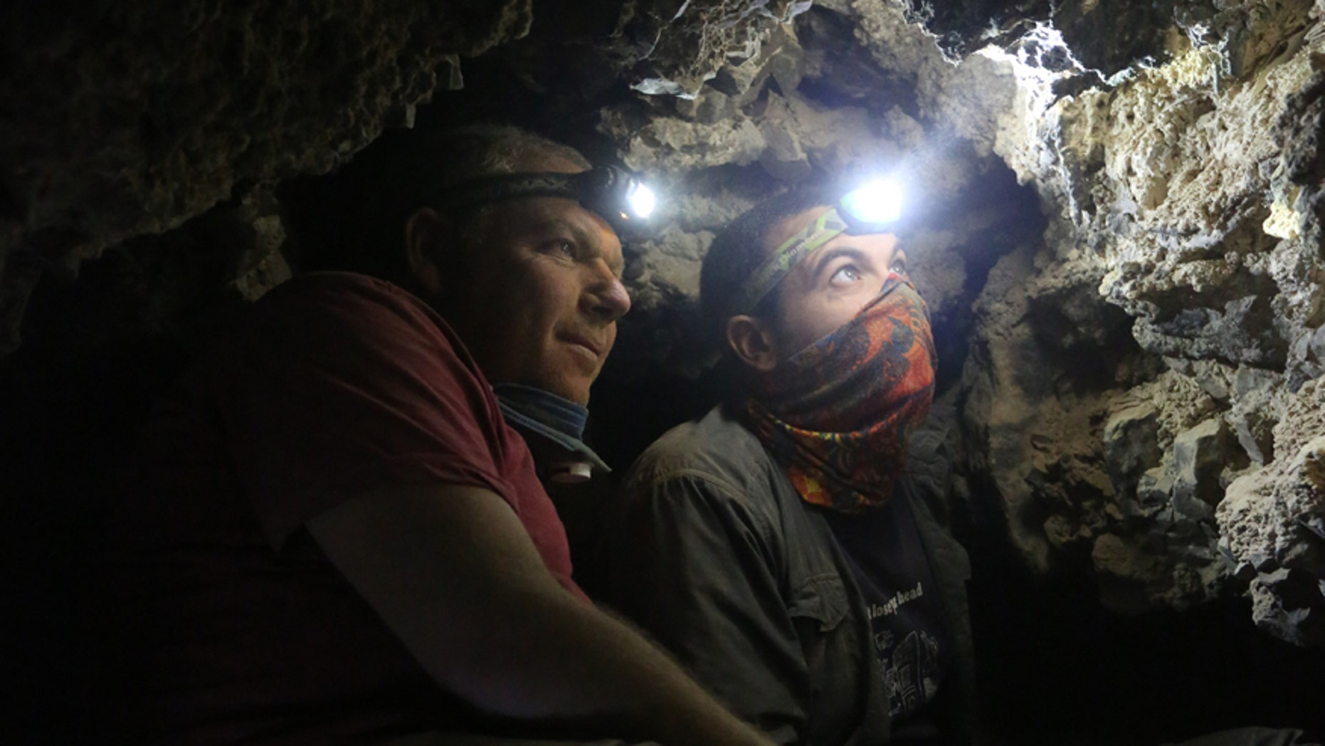 Archaeologists Oren Gutfeld & Ahiad Ovadia survey the cave.
