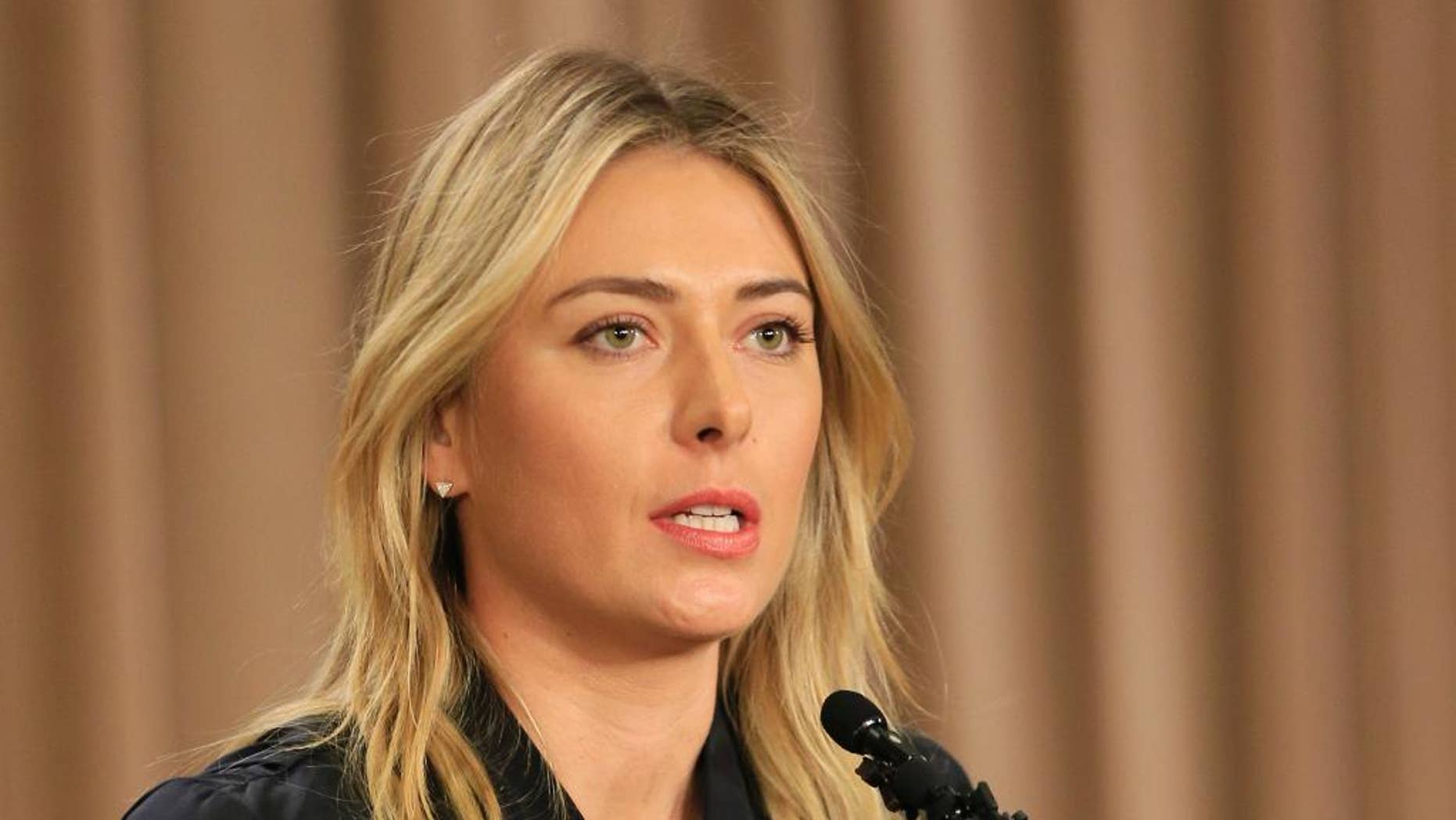 """FILE - In this March 7, 2016, file photo, Maria Sharapova speaks about her failed drug test during a news conference in Los Angeles.   International Tennis Federation president David Haggerty Wednesday April 20, 2016 said a disciplinary hearing is scheduled in Maria Sharapova's doping case, with a ruling possible before Wimbledon. Haggerty told reporters the independent Tennis Integrity Unit typically takes """"two to three months"""" to process a case. That would suggest a verdict in June.(AP Photo/Damian Dovarganes, File)"""