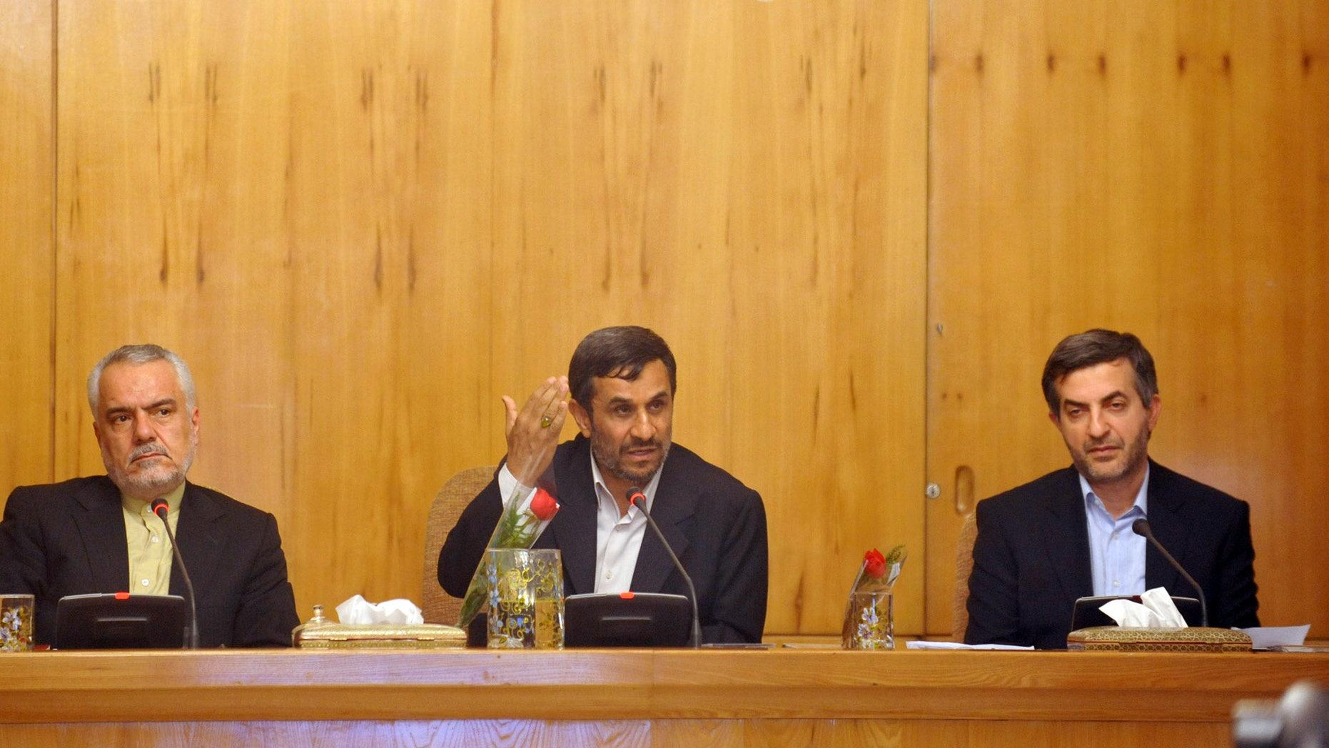 In this Sunday, May 1, 2011 file photo, Iranian President Mahmoud Ahmadinejad, center, speaks, as his office director, Esfandiar Rahim Mashaei, right, and Vice-President Mohammad Reza Rahimi, listen, in a cabinet meeting, in Tehran, Iran. (AP/IIPA/File)